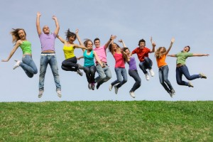 group of happy healthy diverse mixed race teens jumping. Image shot 2009. Exact date unknown.